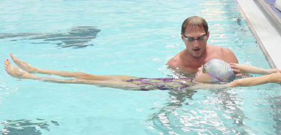 Pete Sczupak teaching a child to swim